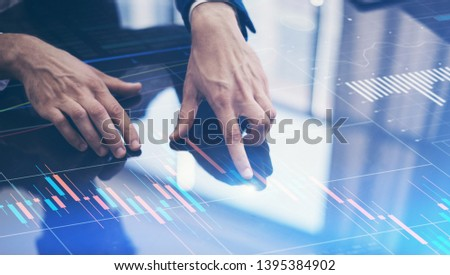 Business analyst is working on financial strategy using modern hi tech digital device #1395384902