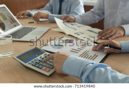Business analyst team checking in financial statement for business valuation. Accounting,financial  Concept.