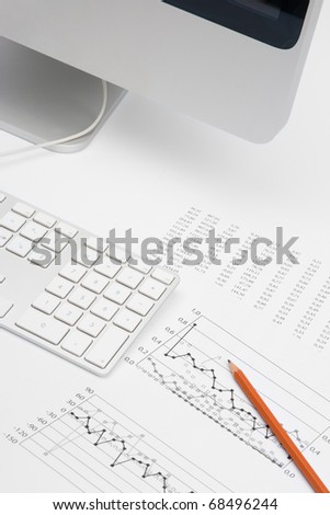 Business analyst workplace - pencil, sheet with numbers, graph, keyboard and part of computer