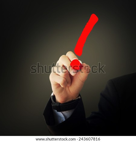 Business and advertisement concept. Close up of businessman drawing a exclamation mark