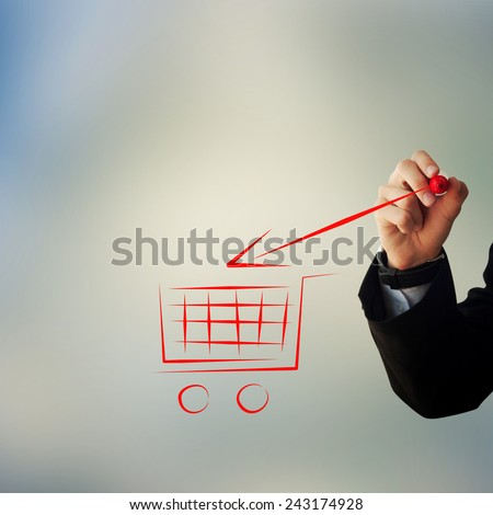 Business and advertisement concept. Close up of businessman drawing a shopping cart