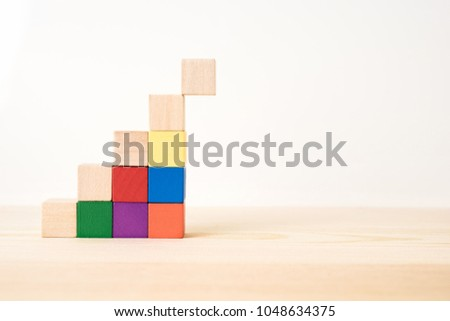 Business and design concept - abstract geometric real wooden colored cube on wooden floor background and it's not 3D render. It's the symbol of support, teamwork and economy  growth #1048634375