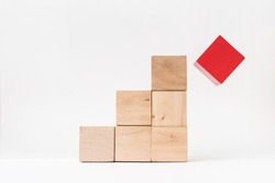 Business and design concept - abstract geometric real wooden cube pyramid on white floor background and it's not 3D render. It's the symbol of make a mistake, fall into a trap