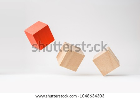 Business and design concept - abstract geometric real wooden cube with surreal layout on white floor background and it's not 3D render. It's the symbol of leadership, teamwork and growth #1048634303