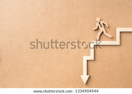 Business and design concept - group of wooden businessman icon and arrow on kraft paper. it's fall, wrong concept #1334904944