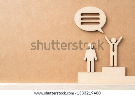 Business and design concept - group of wooden businessman icon with dialogue frame on kraft paper. it's conversation, leadership concept #1333219400