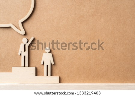 Business and design concept - group of wooden businessman icon with dialogue frame on kraft paper. it's conversation, leadership concept #1333219403