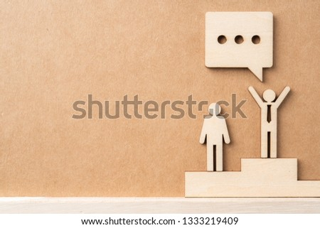 Business and design concept - group of wooden businessman icon with dialogue frame on kraft paper. it's conversation, leadership concept #1333219409