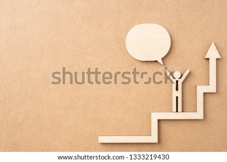 Business and design concept - group of wooden businessman icon with dialogue frame on kraft paper. it's conversation, leadership concept #1333219430