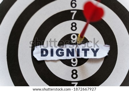 Business and finance concept. A piece of paper with the text is nailed to the target with a dart - DIGNITY Сток-фото ©