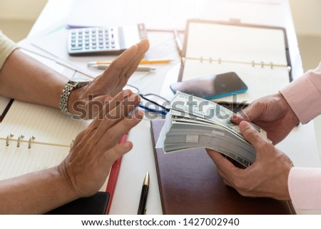 Business and finance concept, Hand of a businessman refuse money from his partner. #1427002940