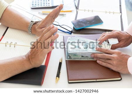 Business and finance concept, Hand of a businessman refuse money from his partner. #1427002946
