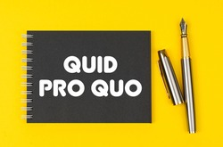 Business and finance concept. On a yellow background lies a pen and a black notebook with the inscription - Quid Pro Quo
