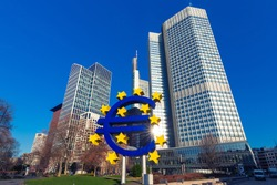 Business and finance concept with giant Euro sign at European Central Bank headquarters in the morning, business district in Frankfurt am Main, Germany.