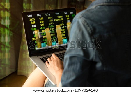 Business and Finance concept,Woman use labtop for daily stock market price and quotations, Business owner use tablet for make profit from stock market.