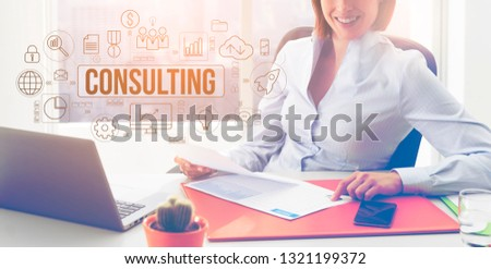 Business and finance professional consulting service: smiling financial advisor sitting at desk and working, flowchart with business and finance icons #1321199372