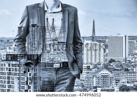 Business and investment concept. Double exposure of business man standing and city background. Blue tone. #474996052