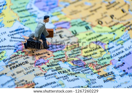 Business and journey concept. The businessman miniature figure walking on the world map for Europe #1267260229