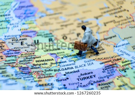 Business and journey concept. The businessman miniature figure walking on the world map for Europe #1267260235