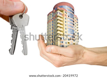 business and mortgage concept. hand with house and keys