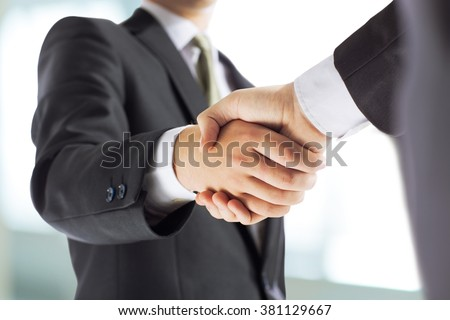 business and office concept - businessman shaking hands each oth #381129667