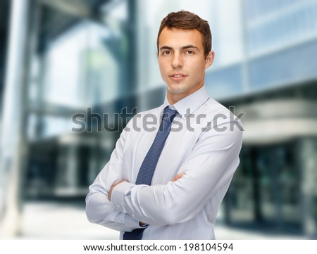 business and office, people concept - friendly young businessman