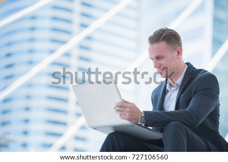 Business and Technology concept,Business man  used labtop sitting at metropolis city