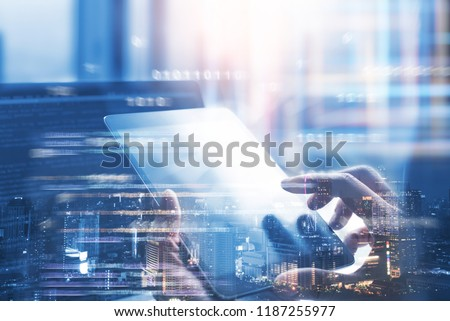Business and technology, software development, IoT concept. Double exposure, man programmer, software developer working on digital tablet and smart city with binary, html computer code on screen #1187255977