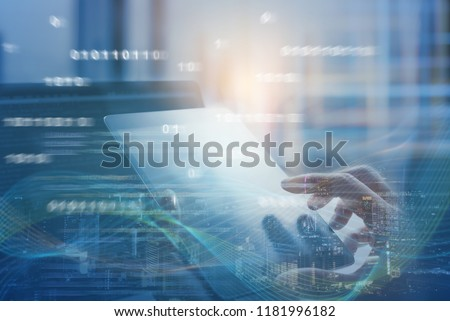 Business and technology, software development, IoT concept. Double exposure of man programmer, software developer working on digital tablet and smart city with binary, html computer code on screen