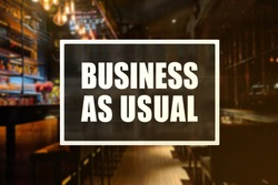 Business as Usual sign of a bar or pub. Concept of resumption or confidence in operations.
