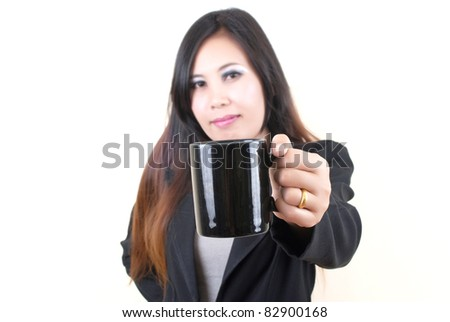 Business Asian lady putting coffee cup.