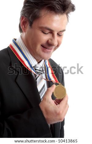 Business awards.   Businessman admires his gold medal
