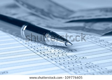 Business background in blues with money, ruler, calculator and pen. - stock photo