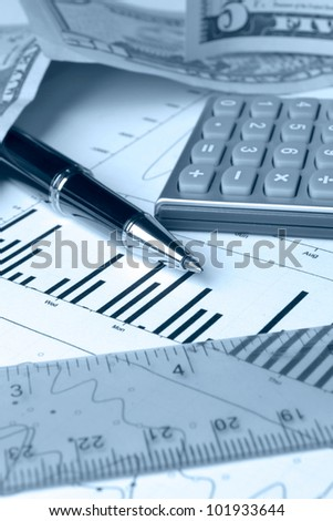 Business background with chart, coins and pen, in blues.