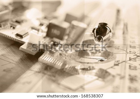 Business background with electronic device and graph, in sepia.