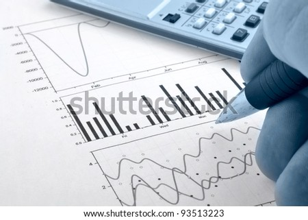 Business background with graph, hand, pen and calculator.