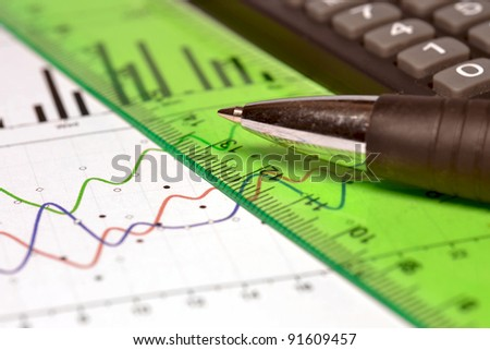 Business background with graph, ruler, pen and calculator.