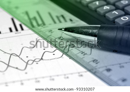 Business background with graph, ruler, pen and calculator, green and blue.