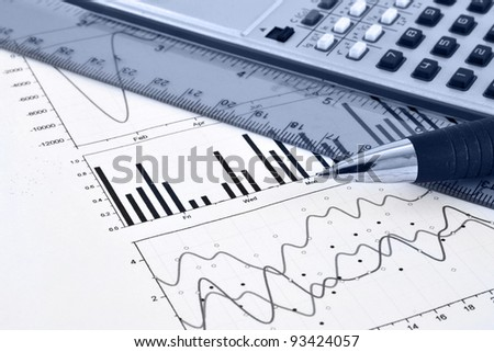 Business background with graph, ruler, pen and calculator, in blues.