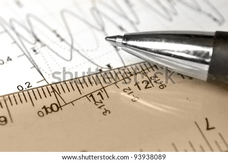 Business background with graph, ruler, pen and calculator, in sepia.