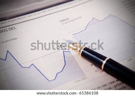 Business background with graphics and pen
