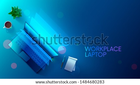 Business background with laptop on workplace top view. Computer screen lights on desk blue light. Nobody on workspace with cup coffee, flower, notepad, pencil. job place workers or freelance.