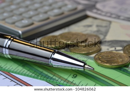 Business background with money, ruler, calculator and pen.