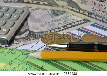 Business background with money, ruler, calculator and pencil.