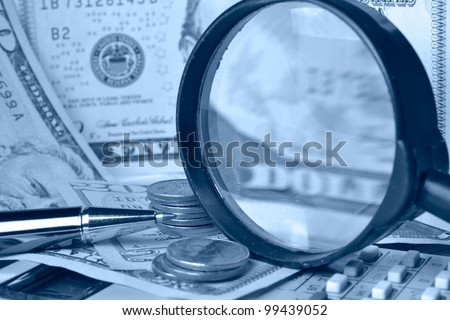Business background with table, coins and pen.