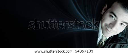 Business banner background with a smiling young business man over an abstract fractal background.