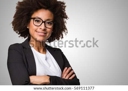 business black woman crossing her arms on a grey background #569111377