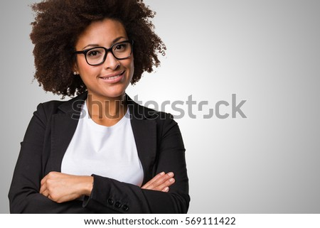 business black woman crossing her arms on a grey background #569111422