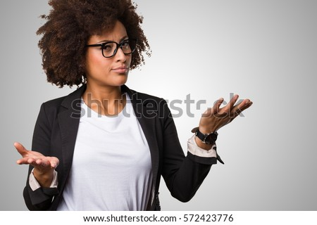 business black woman doing balance gesture