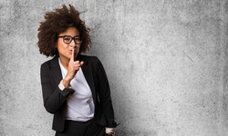 business black woman doing silence gesture